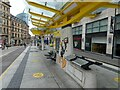 SJ8398 : Exchange Square tram stop with Daffy Duck by Gerald England