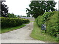 TG2431 : Private Road to Home Farm by David Pashley