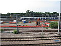 TQ2282 : TfL train at site of Old Oak Common main line station by David Hawgood