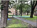 TQ3371 : Playspace beneath old trees, Kingswod Estate, East Dulwich by Robin Stott