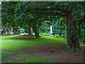 NY5228 : Under the yew trees, St Wilfrid's Chapel, Brougham Hall by Humphrey Bolton