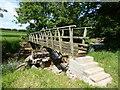 NY6717 : Footbridge near Dougles Ing by Adrian Taylor