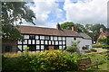 SO4491 : Little Stretton dwellings by Bill Harrison