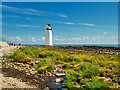 NX9754 : Lighthouse at Southerness Point by David Dixon