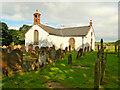 NY1068 : Ruthwell Church and Churchyard by David Dixon