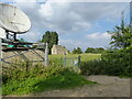 SO8818 : Communications dish with reservoir buildings, Chosen Hill, Churchdown by Ruth Sharville
