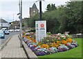 NT4936 : Flower beds and Covid posters, Galashiels by Jim Barton