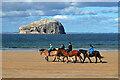NT6084 : Horse riders at Seacliff Beach by Walter Baxter