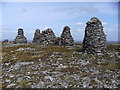 NY8206 : Cairns on the summit of Nine Standards Rigg by John Illingworth