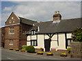 SJ3277 : Old Cottages, Willaston by Sue Adair