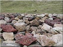 SH1626 : Multi coloured boulder sea defences at Aberdaron by Peter Shone