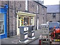 NT9928 : Shop front, Wooler. by Richard Webb
