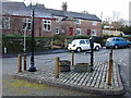 SJ4768 : Great Barrow village hall, pump in the foreground. by Stephen Charles