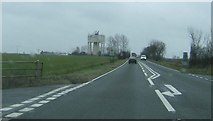 TM1888 : Water tower A140 by Phil Davies