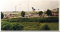 TL5523 : Car park and planes at Stansted Airport by Hazel
