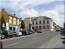 S8573 : Street scene with statue of Father John Murphy, Tullow, Co. Carlow by Humphrey Bolton