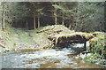 NY7023 : Broken bridge over Keisley Beck by Stephen Craven