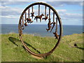 NZ6921 : Cast iron sculpture created from a mining winding wheel by Phil Catterall