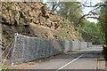 NY7263 : Rock Fall Fence protecting road by Ray Barnes