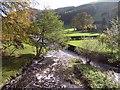 SJ1532 : River Ceiriog and St Garmon's Church by Peter Craine