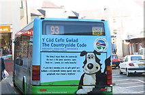 SH4862 : A Bilingual Reminder of the Countryside Code at Caernarfon Bus Station by Eric Jones