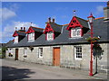NJ6815 : Estate Cottages in Monymusk by Richard Slessor