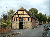 SP7006 : Tithe Barn by St Mary the Virgin by Chris Wilson