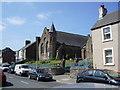 NX9925 : United Reformed Church, Harrington by Alexander P Kapp