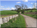 NU0219 : Rural road by Walter Baxter