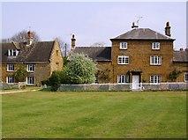 SP4147 : Houses around Warmington village green by Graham Horn