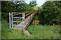 SO6774 : Footbridge over the River Rea by Philip Halling