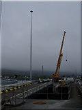 J1418 : New 30m mast lighting  Warrenpoint Harbour by HENRY CLARK