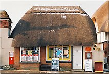 SU1734 : Winterbourne Dauntsey: snow-topped thatched post office by Chris Downer