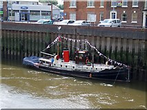 TF3243 : Boat on the River Witham, Boston by Dave Hitchborne