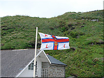 SX0486 : RNLI flag at Trebarwith by John Lucas