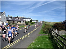 NU2424 : Runners in Low Newton-by-Sea by Chris Heaton