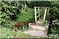 NY3942 : Footbridge over Roe Beck by Phil Davies