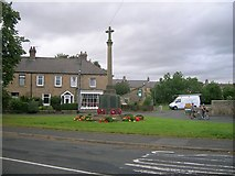 NZ1164 : Wylam war memorial by Newbiggin Hall Scouts