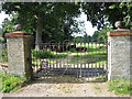 TG0539 : Park Gate to Bayfield Hall near Home Farm by Zorba the Geek