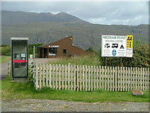 NH1098 : Ardmair Point Holiday Centre & phone box by Nick Mutton