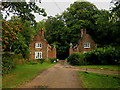 TG1027 : Heydon Hall Lodges (west entrance) by Zorba the Geek