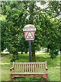 TG0337 : Village Sign, Sharrington by Evelyn Simak