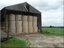 SU6615 : Hambledon: bales in barn by Chris Downer