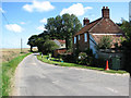 TG1139 : East past cottages near Bodham Common by Evelyn Simak