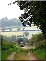 TG0438 : View E across farmland from a track near Breck Farm by Evelyn Simak