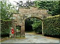 NY4738 : Imposing gateway with postbox, Brackenburgh Estate by Rose and Trev Clough
