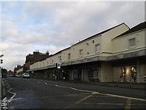 NS3980 : Row of shops, Alexandria Main Street by Stephen Sweeney