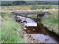 NY5482 : Road bridge over The Beck Burn by Walter Baxter