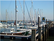 SZ3394 : Boats at the mouth of the River Lymington by Margaret Sutton
