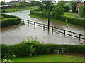 SJ5873 : Small Brook at Ruloe in flood by Steve Burrows